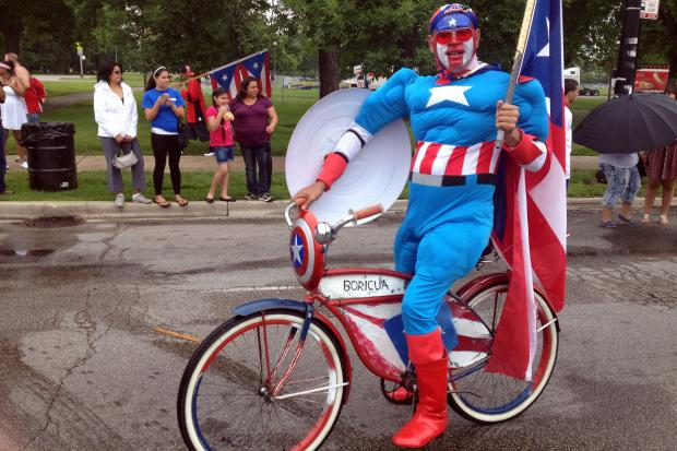 "Proud Puerto Ricans who braved the rain in droves Saturday were rewarded when the morning showers ceased just as the annual parade set off on Division Street. They danced, sang and shouted ""Boricua"" as the procession passed by."