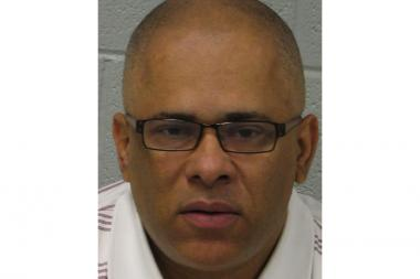 CeaseFire Illinois Director Tio Hardiman was charged with domestic battery in suburban Hillside Friday morning.
