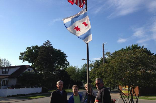 "A group of four Edison Park residents has maintained ""The Triangle,"" a small patch of land on the city's border with Park Ridge that has flowers and a City of Chicago flag."