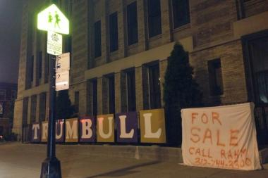 "A mock ""For Sale"" sign put in front of Trumbull in May after the Board of Education voted to close it."