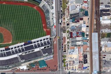 The area behind Wrigley Field's right field seats would get a patio and a walkway that extends to the Addison Red Line station, under one proposal.
