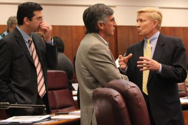 Ald. Bob Fioretti (right) talks with Aldermen Scott Waguespack and Ricardo Munoz during Wednesday's City Council meeting. All signed on to the ordinance to redistribute funds to CPS.