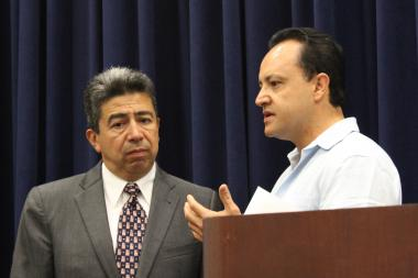 Aldermen Danny Solis and George Cardenas discuss last weekend's immigration raid before their Wednesday news conference.