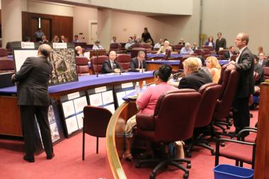 Ald. Tom Tunney (right) examines the Cubs' Wrigley Field presentation to the Zoning Committee Tuesday.
