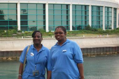 Anita Womack and Tarita Baugh, who have both been employed by the Shedd Aquarium for more than 20 years.