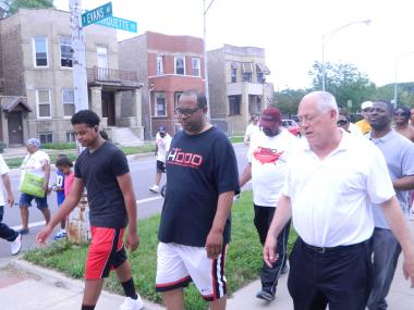 Gov. Pat Quinn joined the Rev. Corey Brooks and members of the New Beginnings Church in an anti-violence march in Woodlawn Saturday.