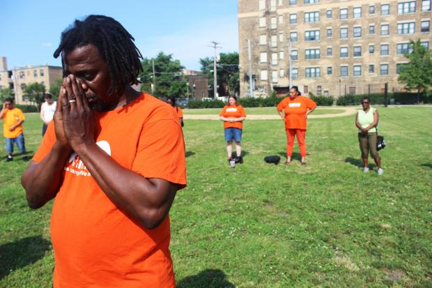 Clergy and community members gathered Monday at Willye B. White Park to pray for an end to recent gun violence.