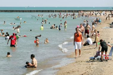 Beachgoers seek relief from the heat along Lake Michigan during an earlier heat wave in Chicago.