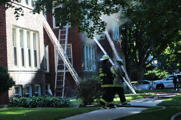 Firefighters were battling the blaze in the 2100 block of West Lunt Avenue, officials said.