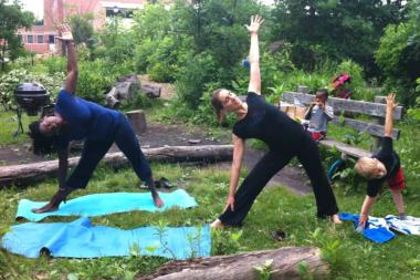Bloom Yoga founder and director Kerry Maiorca (center) leads an outdoor yoga class at Waters Elementary School.