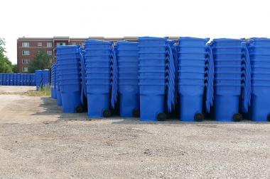 Stacks of blue carts sit ready for delivery to homes at a city facility on the Far Northwest Side.