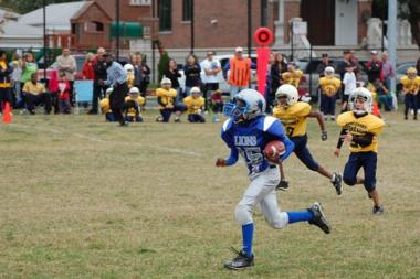The Canaryville Lions team is looking for kids between the ages 8-14. Once the kids are signed up, coaches will put them through two hours of practice each weekday in the early season, plus scrimmages and weekend games.