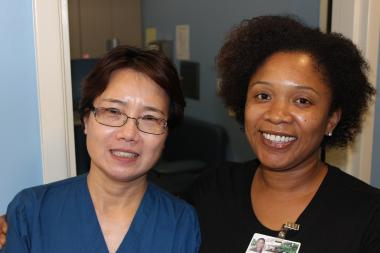 Dr. Xiang Yang (l.) and Malaika Futrell work at The Clinic at Wal-Mart, where free diabetes testing is available on Tuesdays.