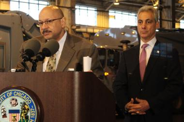 Streets & Sanitation Commissioner Charles Williams and Mayor Rahm Emanuel at an April news conference announcing the completion of the transition to a grid-based system for garbage pickup.