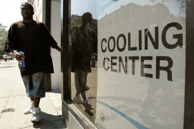 A man departs a City of Chicago Cooling Center Aug. 1, 2006.