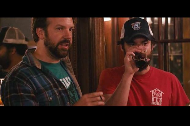 "Actor Jake Johnson wears Red Door Animal Shelter's red T-shirt in his new flick ""Drinking Buddies."""