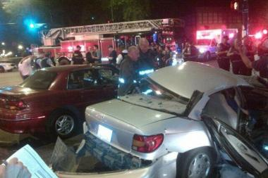 A 35-year-old woman was killed when a fleeing gunman caused a four-car crash in Humboldt Park.
