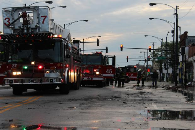 Firefighters put out a large fire in the 300 block of East Pershing Road early Tuesday. One person was taken to the hospital, according to the Chicago Fire Department.