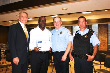 Cornell Wrightington was awarded a certificate by Near North Police District CAPS Officer Chris Schenk Tuesday.