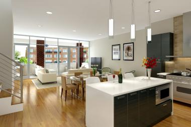 The kitchen/dining room of a luxury condo at 1611 N. Hermitage Ave. in Bucktown features an open floor plan and lots of natural light.