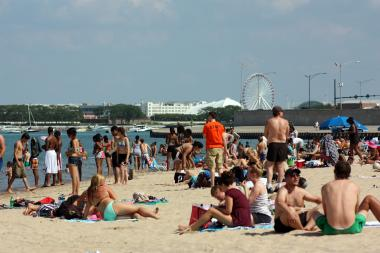 People take to Oak Street Beach during a hot day in Chicago.
