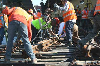CTA workers replace track at the Kimball Brown Line station.