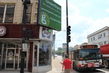 A new electronic billboard at 35th and Halsted streets has residents complaining.