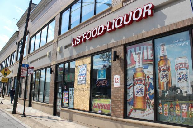 A liquor store clerk is in critical condition after being attacked with a claw hammer during a robbery, authorities said.