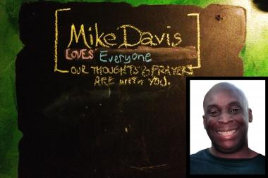 A chalkboard eulogizes Michael Davis in the bathroom of the Poitin Stil, where he broke up a bar fight between his alleged attackers and another patron.