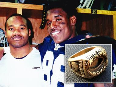 Former Notre Dame linebacker Jimmy Friday (l.) had his 1996 Orange Bowl and 1999 Gator Bowl rings returned to him by two Chicago police officers. The rings were stolen back in 2002.