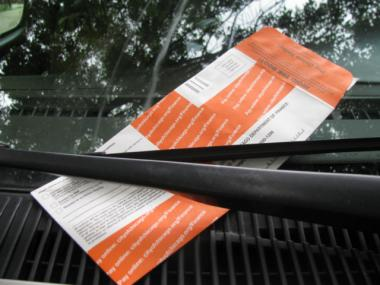 One of the approximately 2.4 million Chicago bright orange parking tickets issued every year.