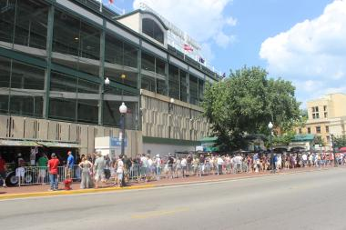 More than 1,000 fans waited in line, some since 6 a.m., to buy original band merchandise from Pearl Jam's Friday show at Wrigley Field.