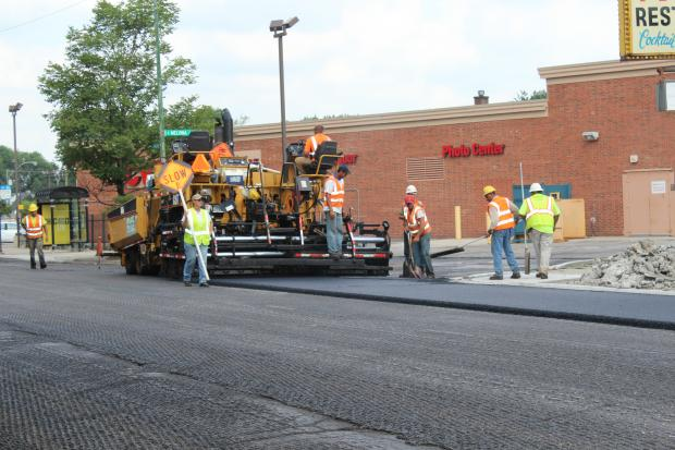 Crews repave Higgins Avenue.
