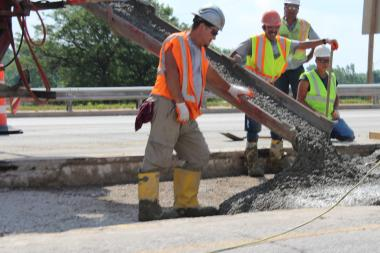 Crews work on the Cumberland Avenue bridge over the Kennedy Expressway.