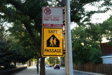 Safe Passage signs have gone up around the city, including this one in front of Wells Elementary, now housed in the former Mayo Elementary building in Bronzeveville.