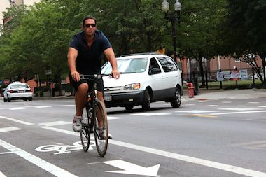 "The city is halfway to adding 100 miles of ""protected"" bike lanes by 2015, the mayor said."