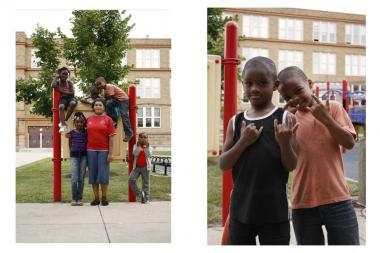 Kids mug for the camera outside Wentworth Elementary, which will merge with Altgeld School when school starts Monday.