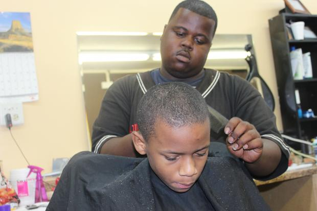 Chicago Public Schools students start classes Monday, and several South Side barbershops are sponsoring free haircuts for them Sunday morning.