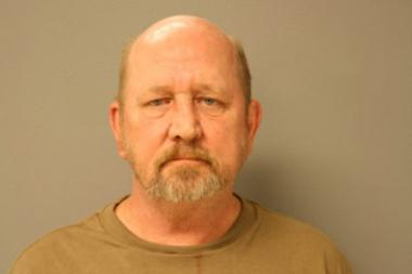 Douglas Markunas, 64, of the 4500 block of South Troy Street, is charged with misdemeanor counts of cruelty to animals and resisisting arrest, among other charges.