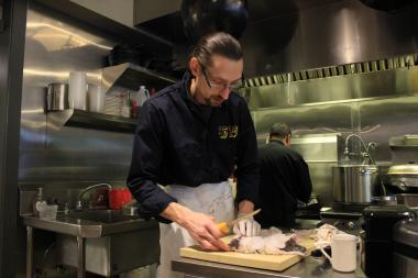Fat Rice owner and head chef Abraham Conlon guts a fish on Nov. 30, 2012.