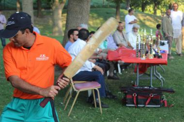A cricket player swings his bat at Warren Park during a tournament last year.