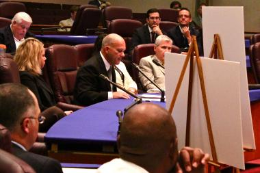 Ald. Scott Waguespack (l., rear) and Ald. Joe Moreno listen to testimony from Ford executive David Kelleher during Wednesday's zoning hearing.