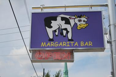 "The ambiguous cartoon cow sign at 1160 W. 18th St. belongs to ""La Vaca Margarita Bar,"" part of a new concept at the old Cuernavaca."
