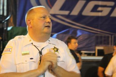 Town Hall Police Cmdr. Elias Voulgaris addresses the crowd before a crime walk in Lakeview on Friday, Aug. 9.