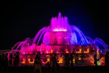 Buckingham Fountain glows at night during Lollapalooza's first day of performances.