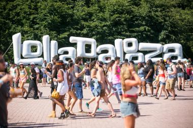Fans walk Grant Park on Day 3 of Lollapalooza 2013.