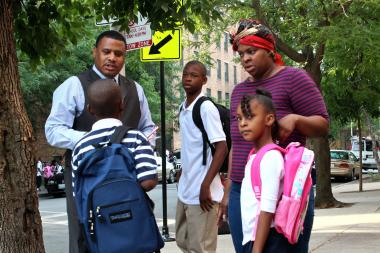 Manierre Elementary principal Derrick Orr speaks with students outside the school Monday morning.