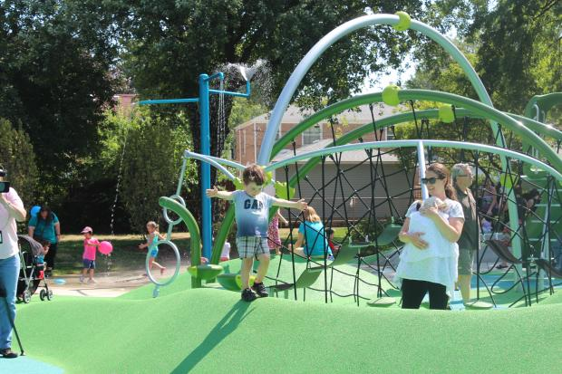 Ten years after residents began working to renovate Merrimac Park, the playground opened Friday.