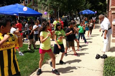 Children participate in a fitness class during a Play Street event.