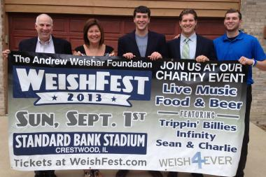 Andrew Weishar's father, Don (from l.); his mother, Jean; brother, Nic; best friend, Parker Carroll; and brother, Danny, hold a poster for Weish Fest, which will take place Sept. 1 at Standard Bank Stadium in Crestwood. Andrew Weishar, a former football star at Brother Rice High School in Mount Greenwood, died from cancer in October.